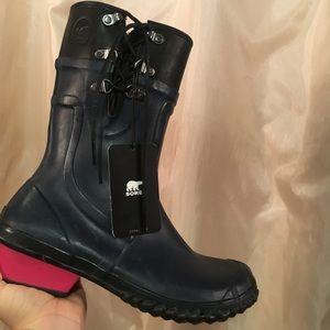 Sorel waterproof rain boots with hot pink heels